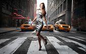 elegant model crossing a NY city street poster