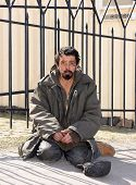 Homeless man on the street of the city. Neurofibromatosis. Three-dimensional skin formation poster