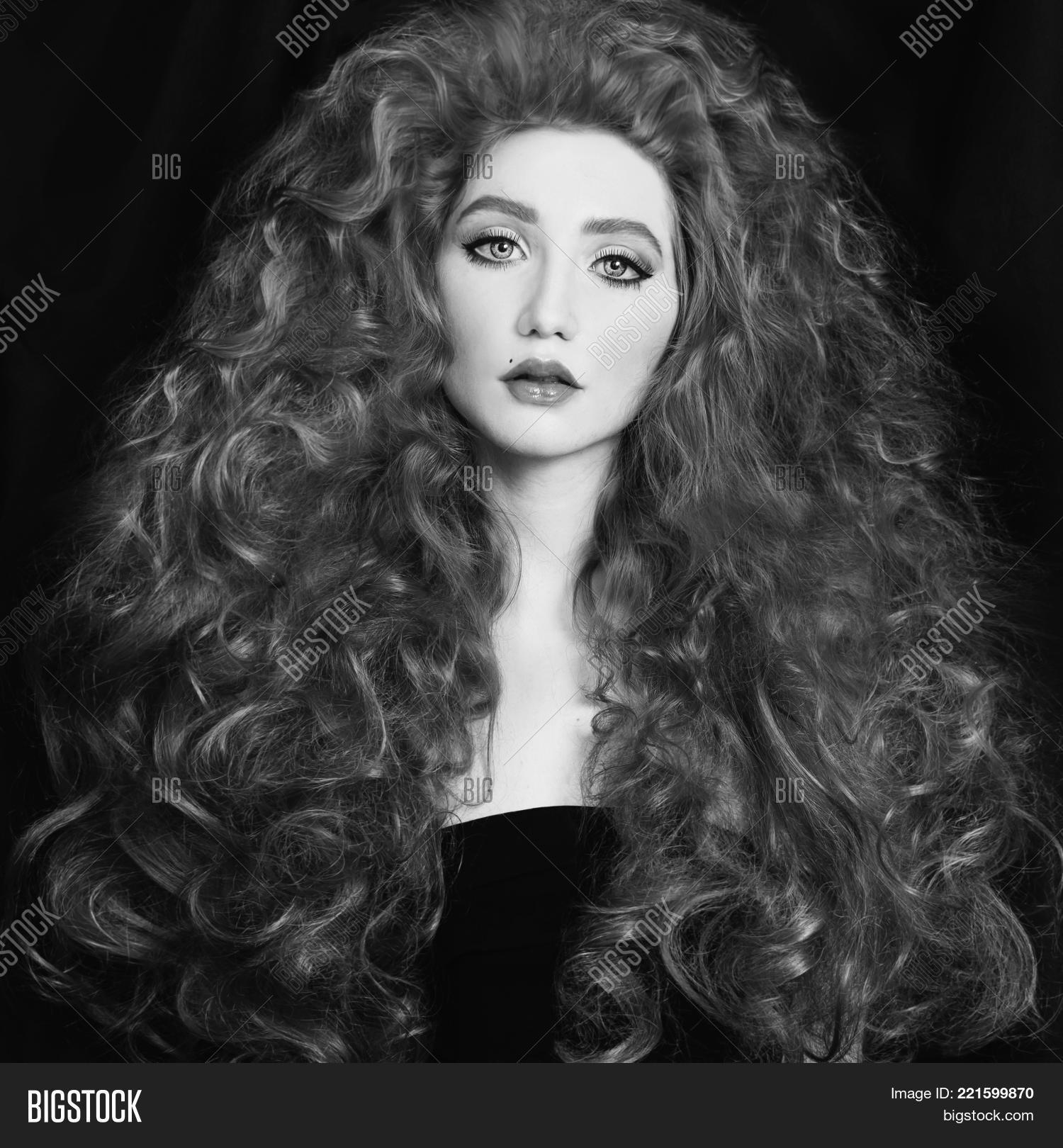 Black and white art monochrome photography woman with very long curly hair black and