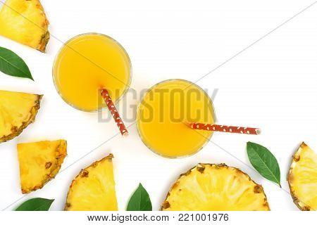pineapple juice in a glass and pineapple slices isolated on white background with copy space for your text. Top view.