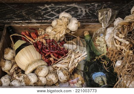 Garlic, a bottle of wine, red pepper and pasta in one of the markets of Rome, Italy