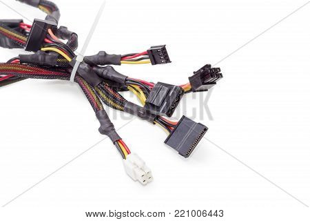 Fragment of the bundle of power cables for computers technology with different connectors closeup on a white background