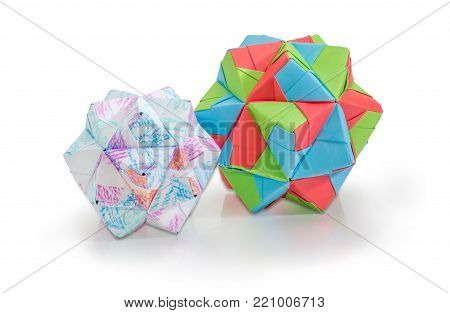 Two dodecahedrons different sizes - three dimensions geometric figure one of the species of polyhedra, made by method of modular origami with various paper on a white background