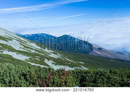 Mountains landscape high peaks scenery wild nature calm scene. Lifestyle active travel hiking. Scenic scenery of wild snowy mountains