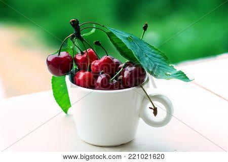 Fresh cherries in bowl on table. Fresh cherries in pot on the table.Cherries. Sweet Cherries. Fresh Cherries. Ripe cherries