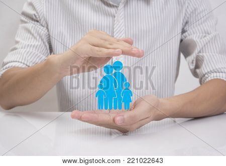 business salesman agent hand holding family icon concept assurance health-care insurance.