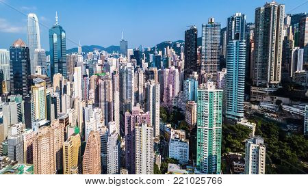 busy metropolis with high crowded buildings in Hong Kong