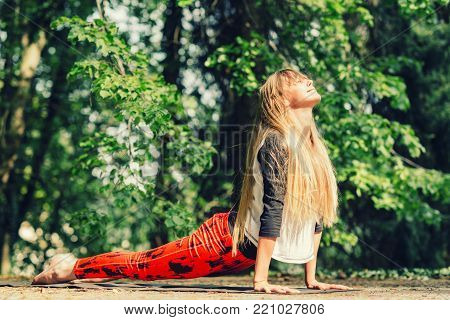 Meditation. Positive Young Woman Meditating Outdoors. One Woman Only