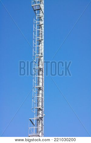 image of one lighting mast at day
