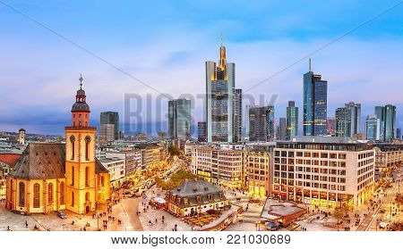 FRANKFURT, GERMANY - NOVEMBER, 2017: View to skyline of Frankfurt in sunset blue hour. St Paul's Church and the Hauptwache Main Guard building at Frankfurt central street Zeil