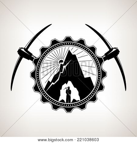 Miner in the Helmet is Holding Pickaxe in the Bowels of the Mountain on a Background of the Sunburst in a Gear with Two Crossed Pickaxes , Vintage Emblem of the Mining Industry
