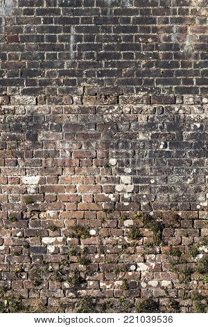 Old large weathered distressed red brick wall background