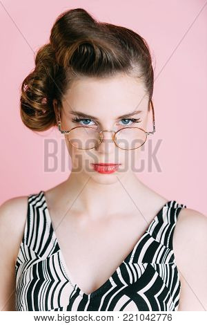 secretary, hairdresser and cosmetics. pinup, youth and look. Beauty and fashion, teacher. Woman with retro hair and fashionable makeup in glasses, pinup. Girl in stylish vintage dress on pink.