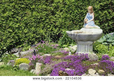 Young Woman Fountain Landscaping