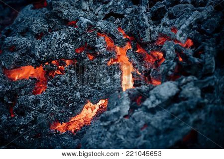 Lava flame on black ash background. Magma textured molten rock surface. Volcano, fire, crust. Danger, hazard, energy concept. Formation, geology, nature, environment. poster