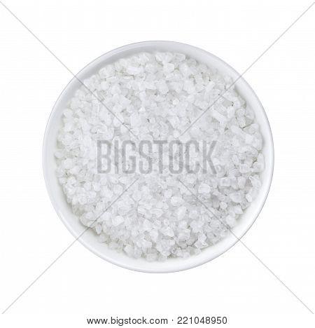 Coarse sea salt on white background closeup top view