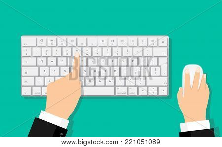 Modern aluminum computer keyboard and mouse. Hands of user. Wireless input device. Closeup of hand typing on keyboard with mouse on green background. Flat Hands typing on white keyboard with mouse