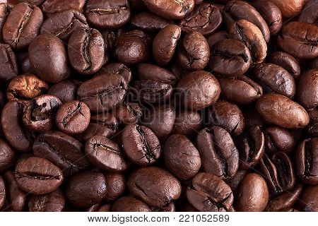 Background of roasted coffee beans close up
