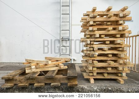 Wooden pallets are arranged in a storage area.