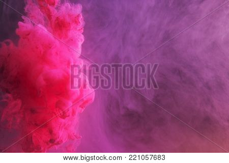 Ink In Water. Ink Swirling In Water. Ink In Water Isolated. Pink Ink In Water On A Black Background.