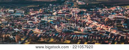Panorama of a small old European town, many small houses, tilt-shift effect