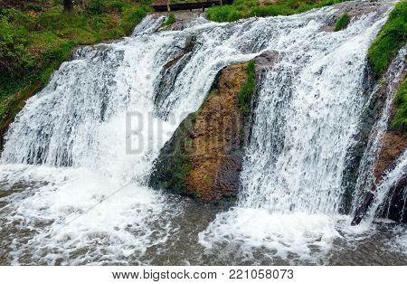 Dzhurynskyi or Chervonohorodskyi cascading waterfall spring view (on the Dzhuryn river in Nyrkiv village, Zalishchyky Region, Ternopil Oblast,  Ukraine.