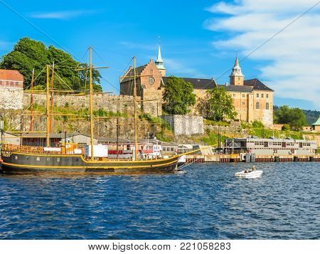 OSLO, NORWAY - JULY 26, 2013: View of the Oslo Harbour and Akershus Fortress. Landmark of Oslo, capital of Norway