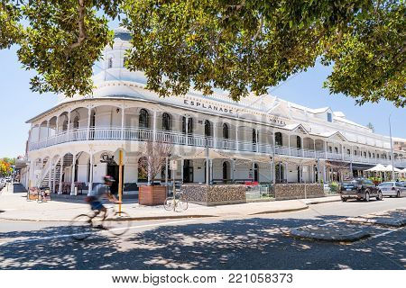 Cyclist (blurred due to long exposure) rides past the Esplanade Hotel, Fremantle, Western Australia, Australia. Photographed: January 8th, 2017.
