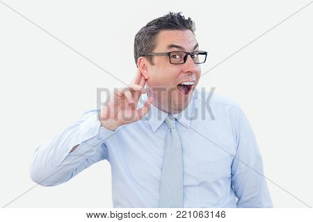 Closeup portrait of joyful middle-aged business man looking at camera and holding fingers near ear. Information concept. Isolated front view on white background.