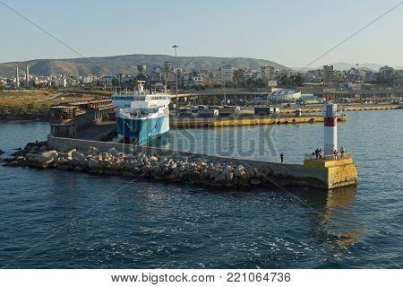 SYROS, GREECE - APRIL 30, 2013: Port of city of Piraeus, Athens, Attica, Greece