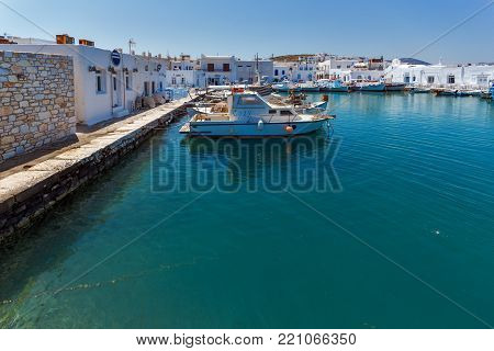 PAROS, GREECE - MAY 3, 2013: Boats at the port of Naoussa town, Paros island, Cyclades, Greece