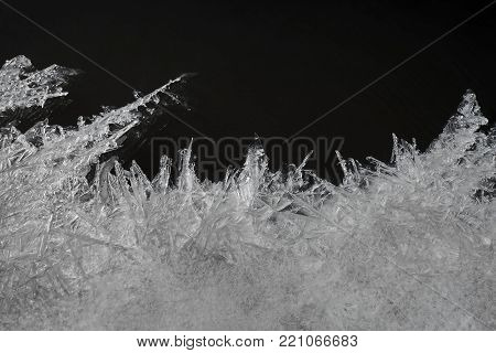The Texture Of Small Ice Crystals On The Dark Background Of The River