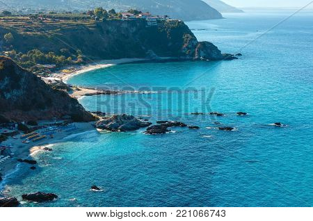 Beautiful Calabrian Tyrrhenian sea coastline landscape. Not far from Capo Vaticano Ricardi, Tropea, Calabria, Italy. People unrecognizable.