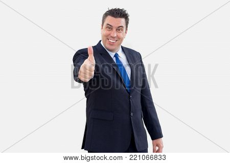 Happy successful male manager showing thumb up and looking at camera. Cheerful satisfied businessman admiring service and giving good assessment. Estimation concept