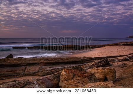 View of the Pedra Branca beach  in Ericeira village, Portugal on late afternoon.