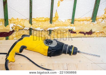 Electric drill on a wooden floor. Repairs in the room