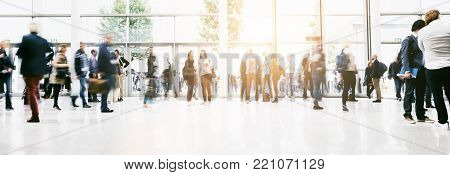 crowd of business people rushing at a entrance of a airport. ideal for websites and magazines layouts