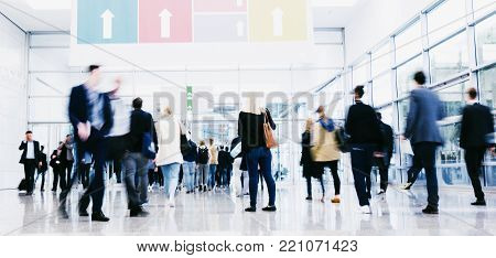 crowd of trade show visitors rushing at a entrance. ideal for websites and magazines layouts