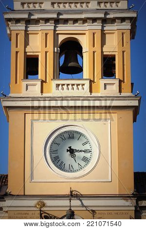 Historic clock tower of Governor Palace in Parma, Italy .