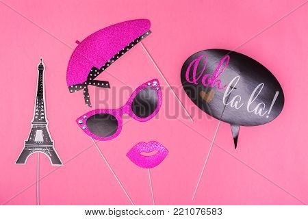 Photo booth colorful props for Valentines day party - eiffel tower, lips, mustache, glasses and word bubble. Happy valentines day greeting card. Copy space