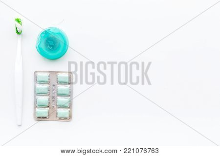 Healty teeth. Daily tools on white background top view.