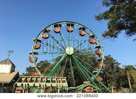 SANTA ANA, CA - DECEMBER 27, 2017: 50 Monkeys Ferris Wheel at the Santa Ana Zoo. The ride is designed to spotlight the Santa Ana Zoo's Fifty Monkey heritage.