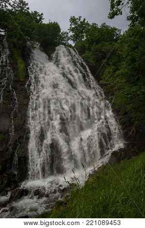 Beautiful Oshinkoshin waterfall on the road from Shari to Shiretoko National Park, Hokkaido, Japan