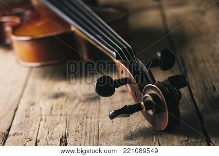 Classic Violin with bow on a wooden table. ideal for websites and magazines layouts