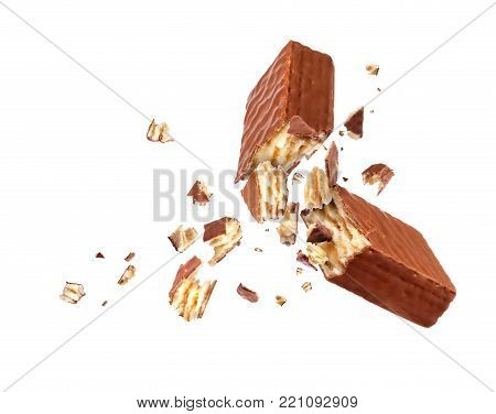 Chocolate waffle broken into two parts isolated on white background