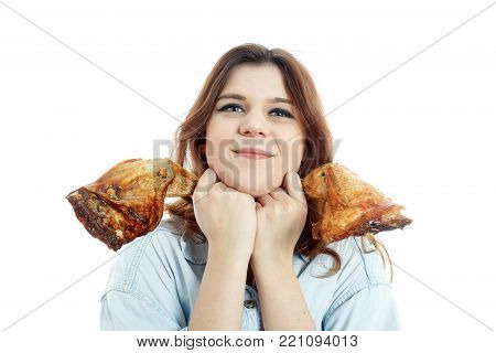 happy young woman show fried chicken feet on white background isolated