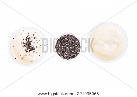Healthy Eating. Natural yoghurt with chia seeds on white background. Studio Photo