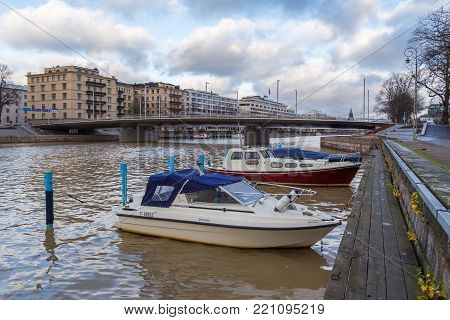 TURKU, FINLAND- November 01, 2013: Boats on the quay of the Aura river in Turku. Turku is the oldest city in Finland and first capital.