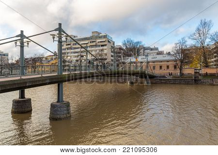TURKU, FINLAND- November 01, 2013: View of the Kirjastosilta, footbridge in over the Aura river in Turku. Turku is the oldest city in Finland and first capital.