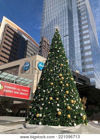 PHOENIX, AZ, USA - DECEMBER 11, 2017: Christmas tree and skating ring sponsored by Arizona Public Service company in celebration of holiday season in downtown of Arizona capital city of Phoenix